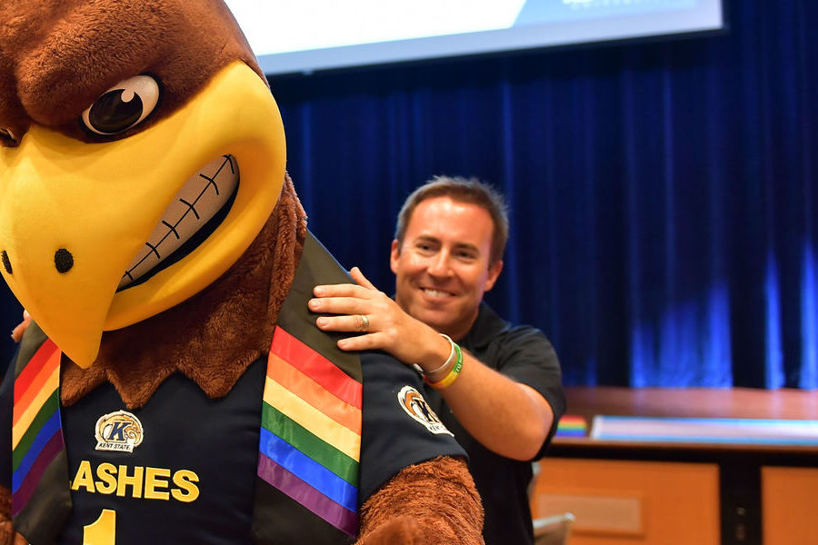 Ken Ditlevson, director of Kent State University's Lesbian, Gay, Bisexual, Transgender and Queer (LGBTQ) Student Center, helps Flash, Kent State's mascot, get ready for a welcome event for LGBTQ students on the Kent Campus.
