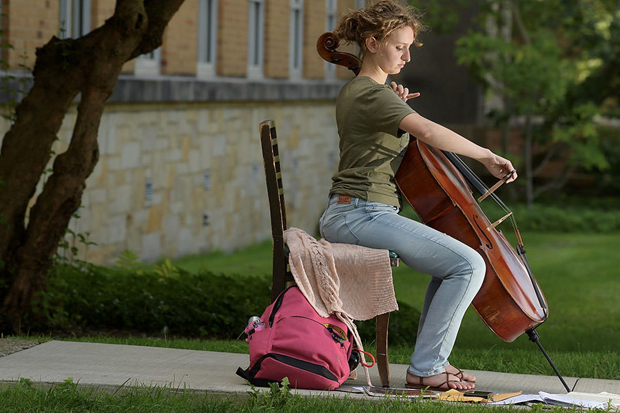 "A student from Kent State University's Hugh A. Glauser School of Music practices in what she calls ""a perfect spot"" on campus. The poor acoustics there help her to better hear – and correct – any flaws in her performance."