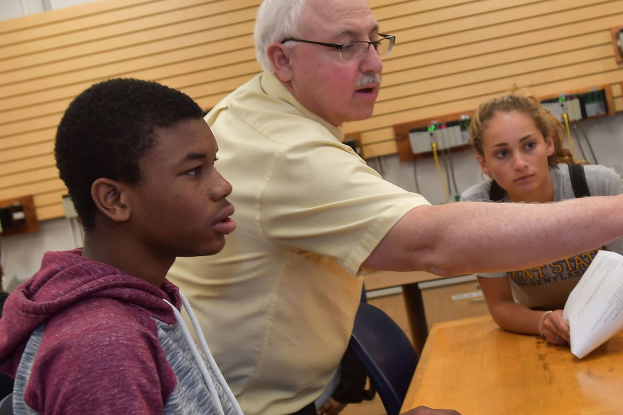 A Firestone Community Learning Center student learns logic control programming from Darwin Boyd, assistant professor of applied engineering and technology, at the Kent State University College of Aeronautics and Engineering.