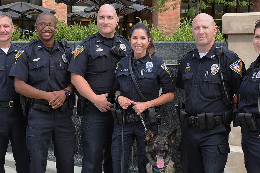 Officers with the Kent State University Police Department stand by the fountain on Risman Plaza near the Kent Student Center. Kent State has been ranked one of the safest campuses in the country by a national trade association.