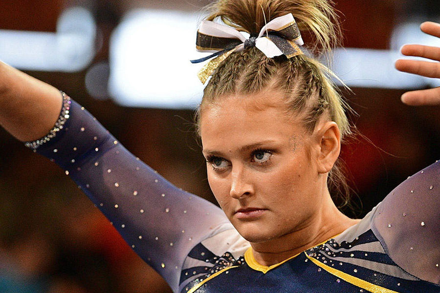 Kent State gymnast Rachel Stypinski focuses as she performs her floor routine at the 2017 Mid-American Conference Gymnastics Championship. (Photo credit: David Dermer)