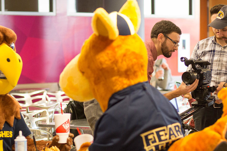 Videographers from Kent State University and the University of Akron prepare a shot in the University of Akron's Student Union with Flash and Zippy.