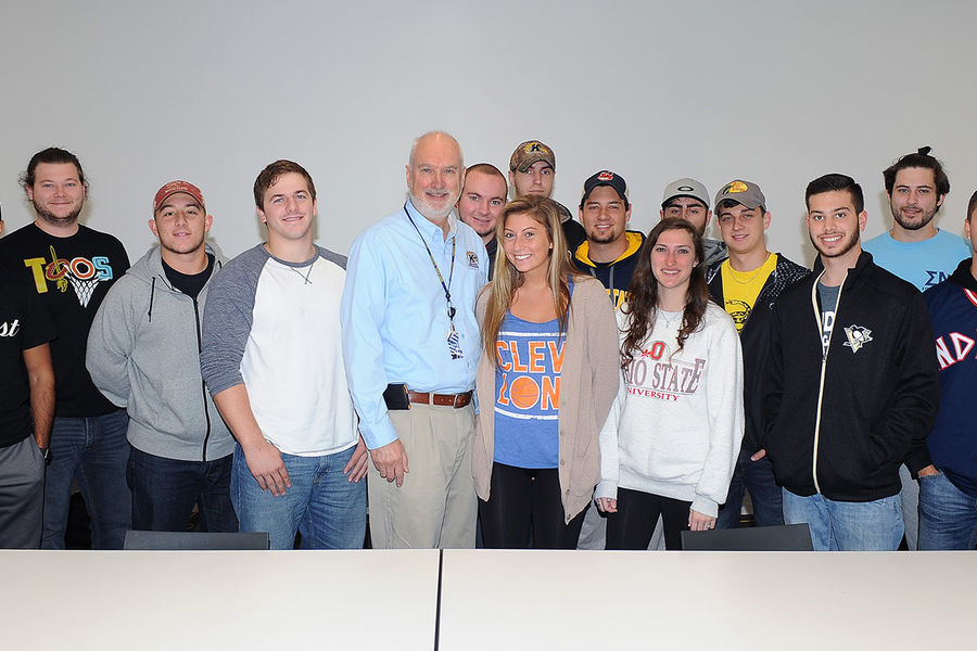 Kent State Associate Lecturer Joseph Karpinski received the 2016 University Teaching Council's Outstanding Teaching Award. Karpinski is surrounded by his students who witnessed the award presentation.