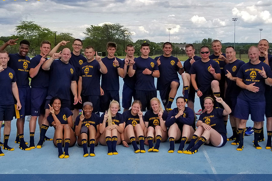Kent State University Police Academy cadets wear socks with their class number stitched in for luck. The group earned a 100 percent on their final physical fitness assessment.