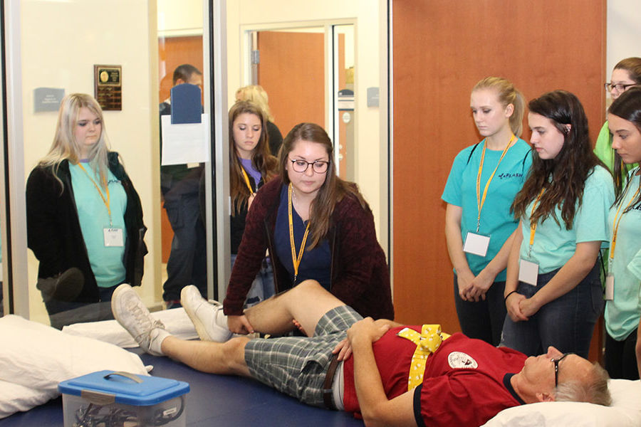 High school students participate in a healthcare simulation event at Kent State University at Ashtabula.