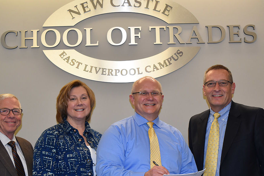 Officials from Kent State University and New Castle School of Trades signed the articulation agreement between both organizations.