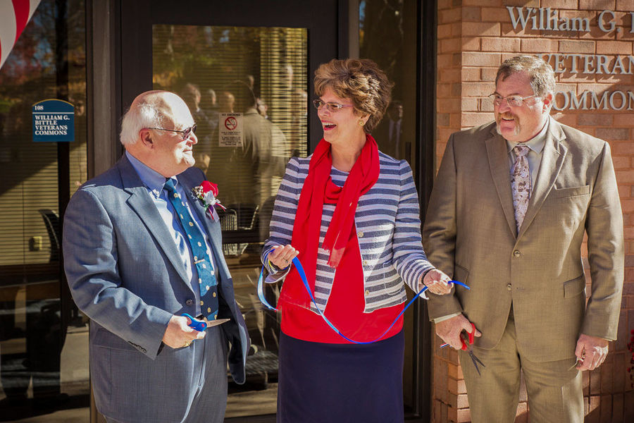William G. Bittle, Ph.D. (left), Kent State Stark Dean Denise A. Seachrist and student veteran Lawrence Weidleman (right) cut a ceremonial ribbon officially opening the William G. Bittle Veterans Commons on Nov. 10.