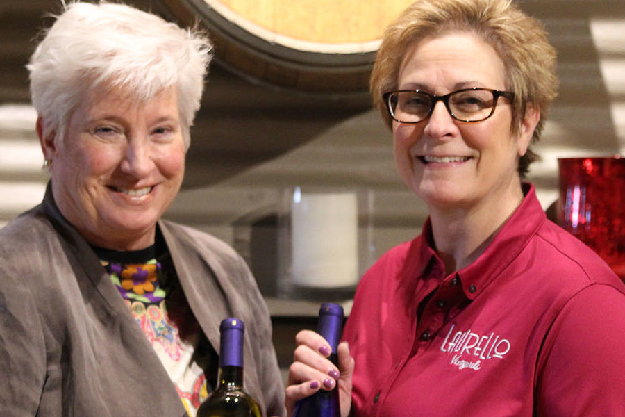 Kent State University at Ashtabula Dean Susan Stocker and Kim Laurello, co-owner of Laurello Vineyards, showcase the first two Kent State Ashtabula wines, which will be bottled by students as part of a unique partnership between the school and the winery.