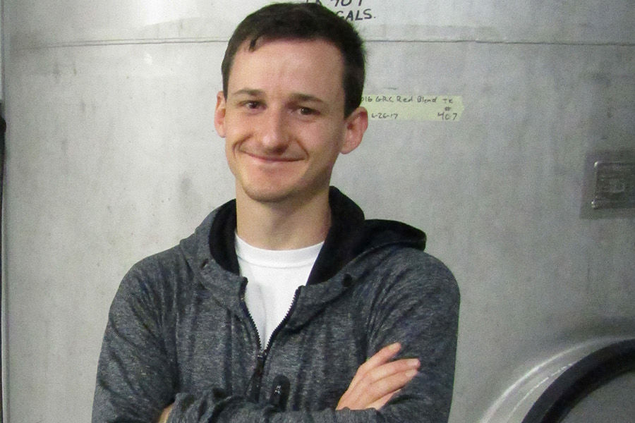 Randy Roberts, a student working toward his associate's degree in enology at Kent State University at Ashtabula, uses his previous degree in biology to help supplement his education.