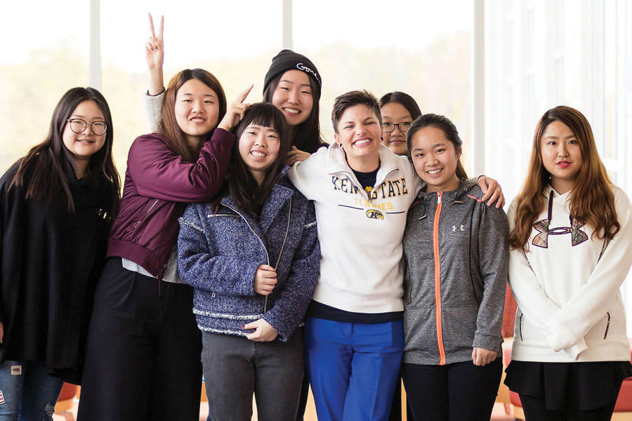 Sarah Schmidt (front row, third from right), outreach program coordinator for global education initiatives at Kent State University at Stark, focuses on expanding opportunities for students.