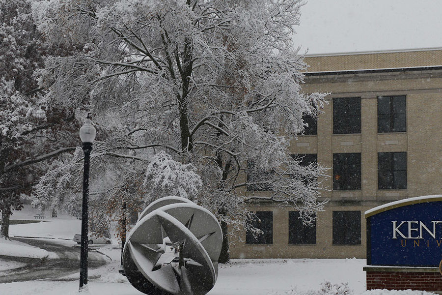 Snow covers the Kent State University campus.