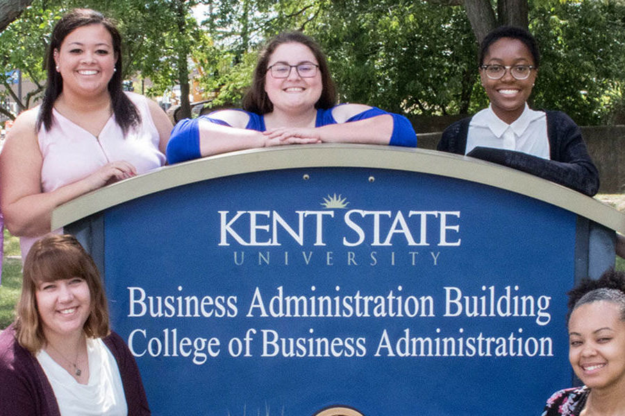 Kent State University students studying in the College of Business Administration pose for a group photo outside the Business Administration Building.