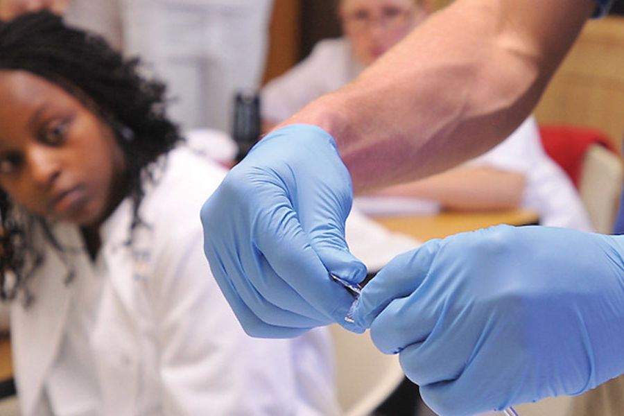 A nursing student watches as her instructor demonstrates how to use a catheter during a class in Henderson Hall.