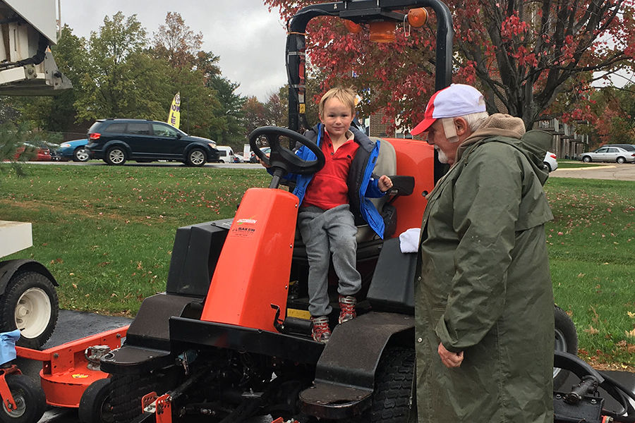 Kids at Kent State University's Child Development Center explored a variety of grounds vehicles during the annual Meet the Trucks event.
