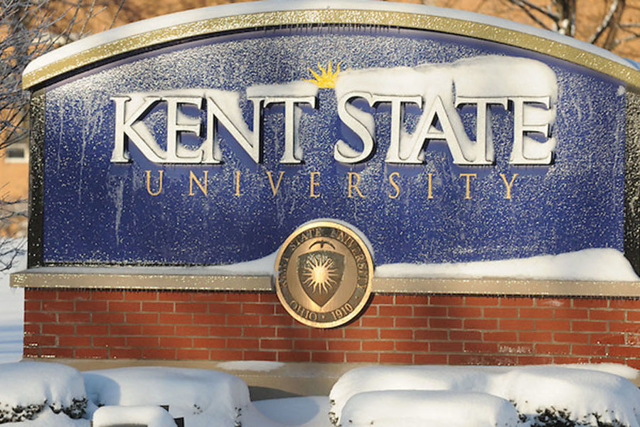 A Kent State University sign is covered in snow. The university