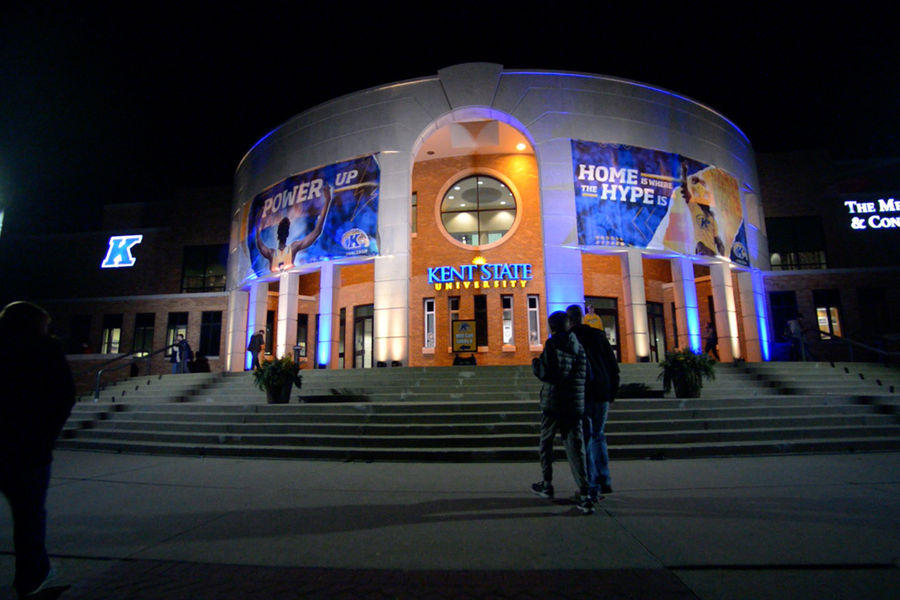 The outside of the MAC Center is illuminated in blue and gold prior to the Kent State men