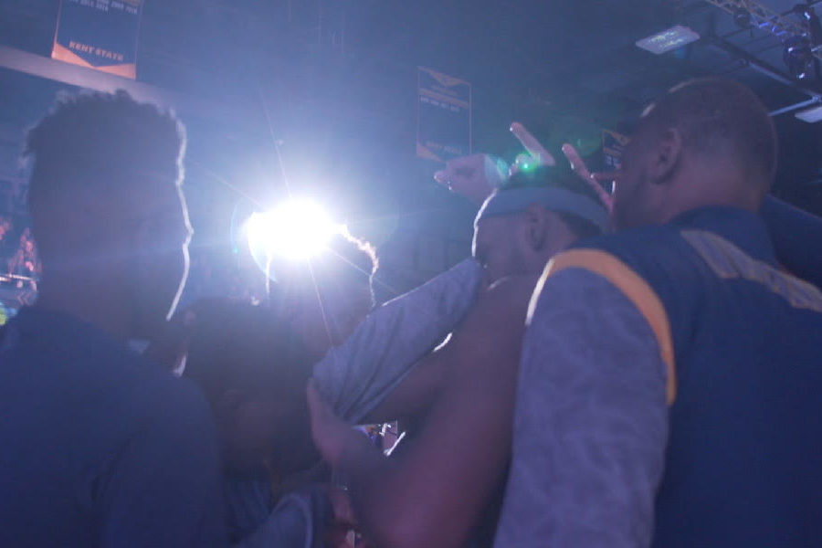 Kent State's Golden Flashes engage in pre-game rituals before tipoff.