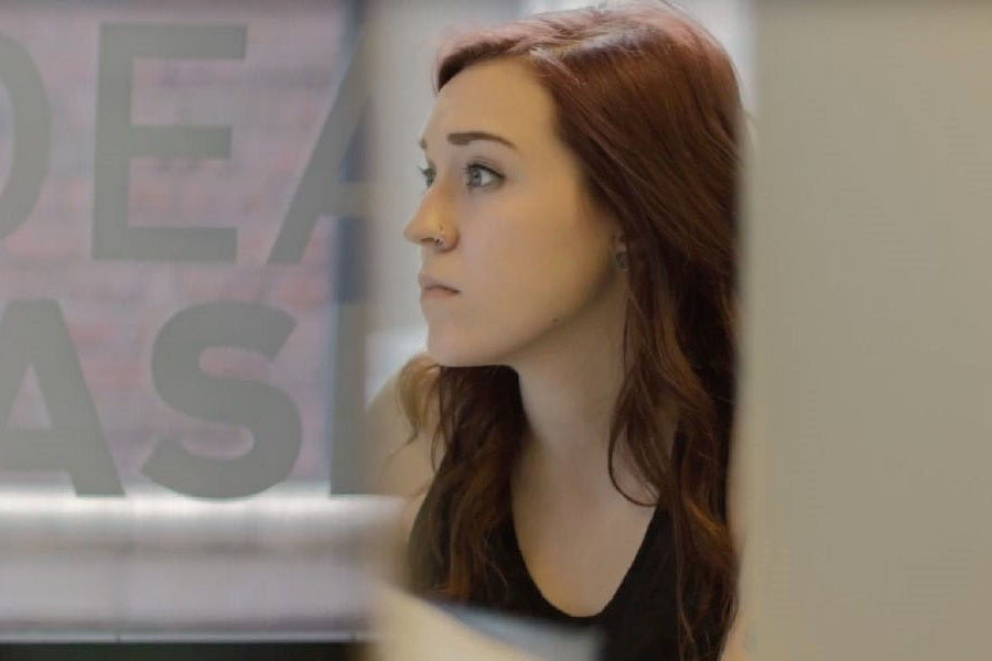 A Kent State University student works at IdeaBase, the student-powered creative agency in downtown Kent, which is a service of Kent State's College of Communication and Information.