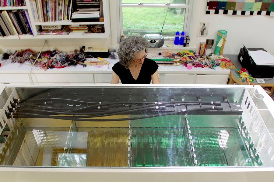 Janice Lessman-Moss, professor in Kent State University's School of Art, demonstrates how the ancient art of weaving has been modernized.