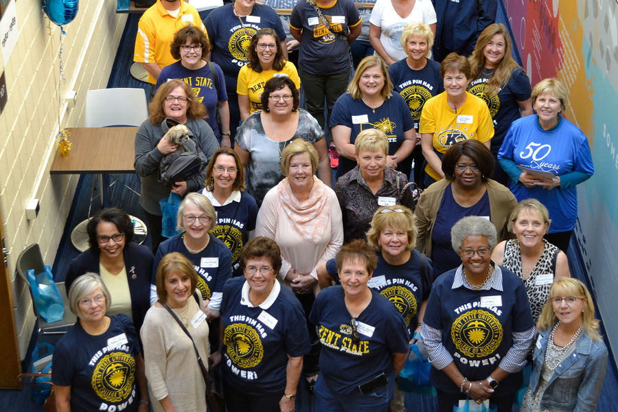 """Alumni representing 50 years of Kent nursing (1971 - 2017) pose for a photo following the """"Nursing 50 Years Strong"""" reception."""