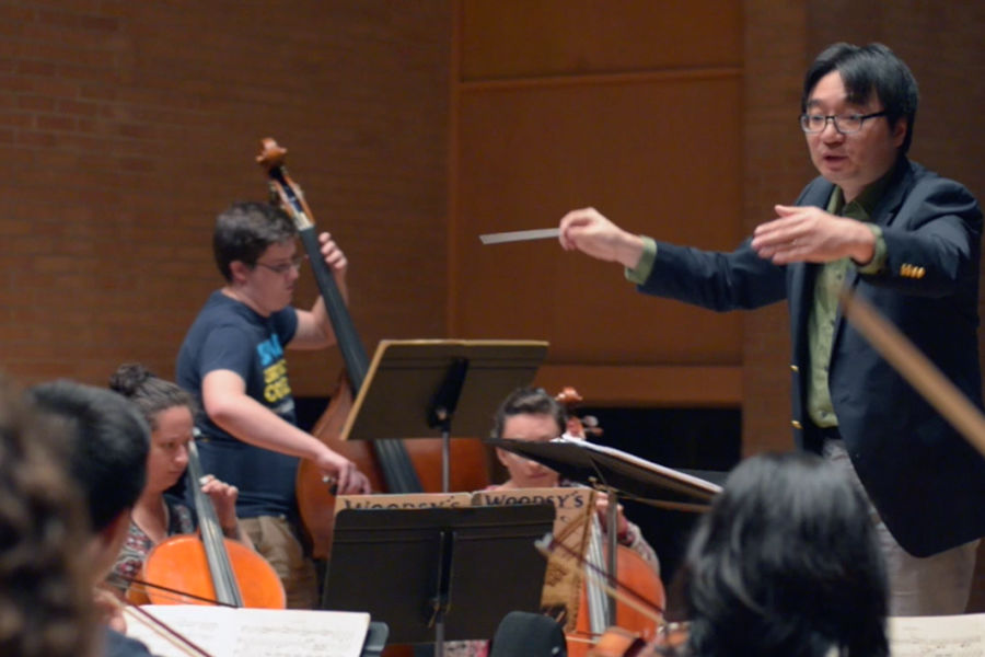 Jungho Kim, Kent State assistant professor of music and orchestra director, directs the Kent State University Orchestra during a rehearsal.