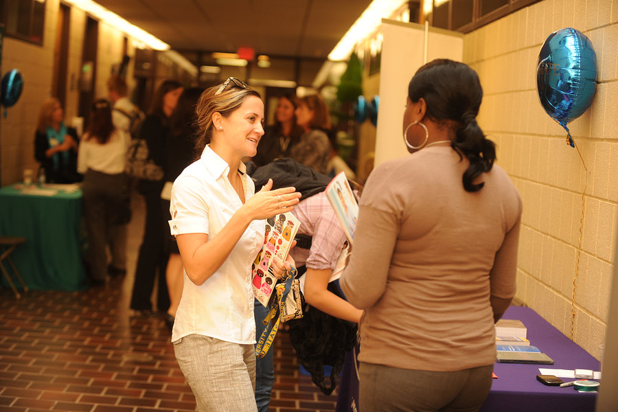 A student discusses a job opportunity with a vendor at the Nursing Job & Career Fair