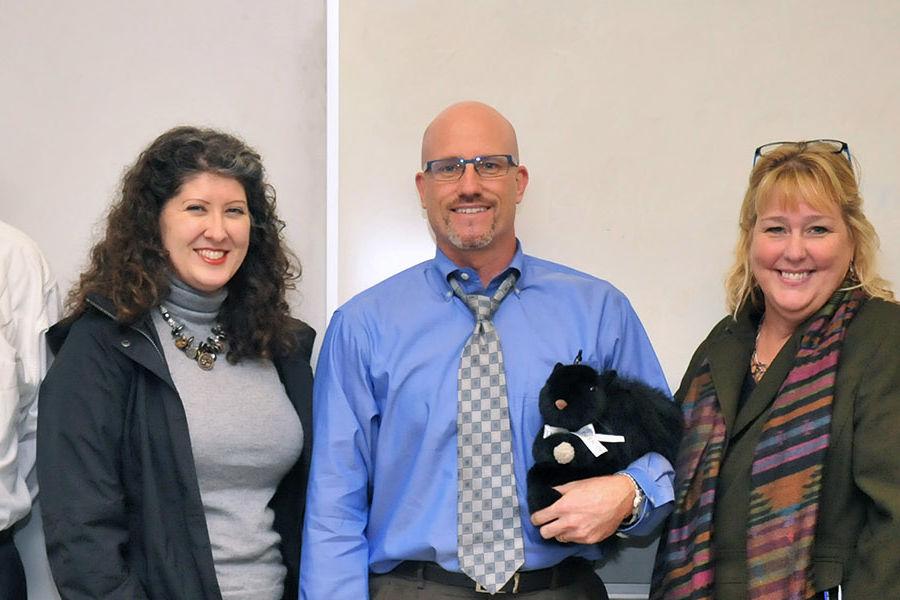 Adjunct faculty member Robert Eckman (center) receives the Outstanding Teaching Award.