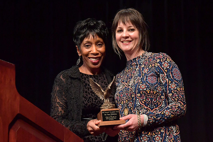 Kent State Assistant Professor Suzy D'Enbeau (right) receives the Diversity Trailblazer Award from Vice President for Diversity, Equity and Inclusion Alfreda Brown.