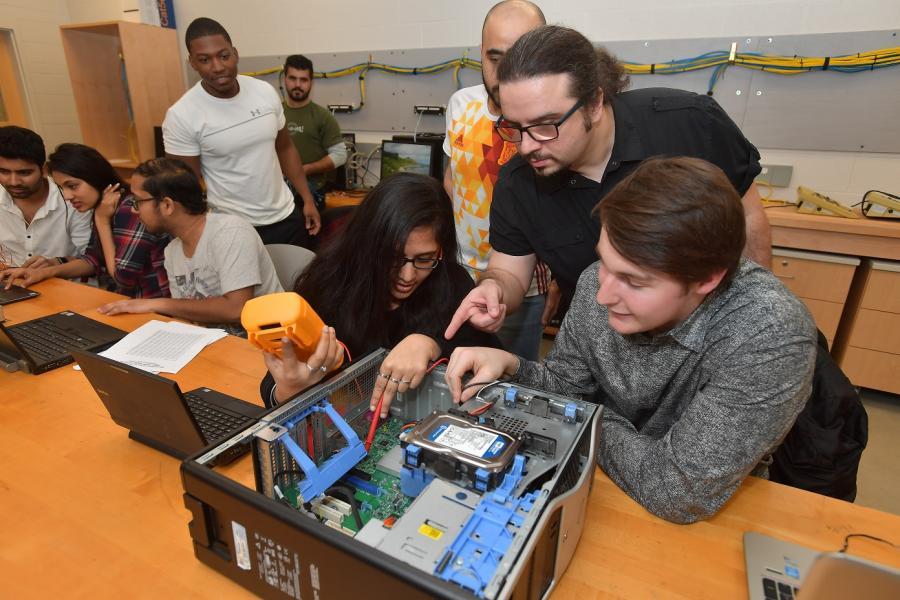 photo Computer Engineering Technology faculty member Evren Koptur instructs students