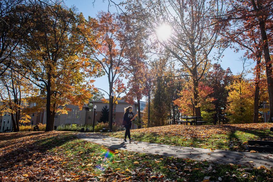 A student walks to class near the Centennial Court residence halls.