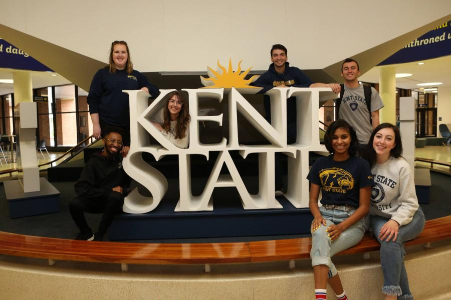 Pooyan and friends posing with Kent State sign