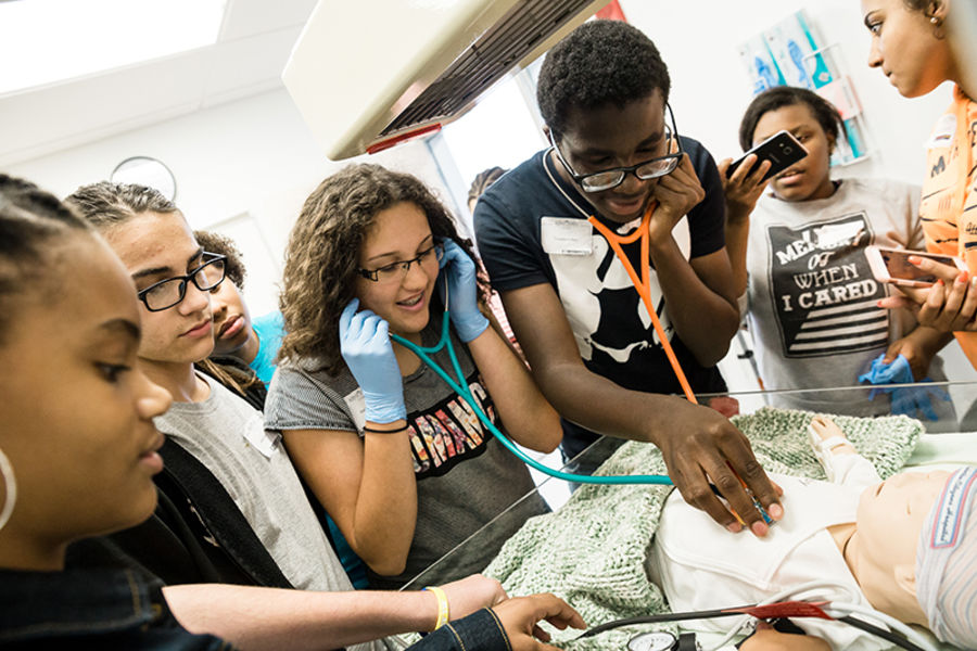 Rising Scholars students during a medical simulation.