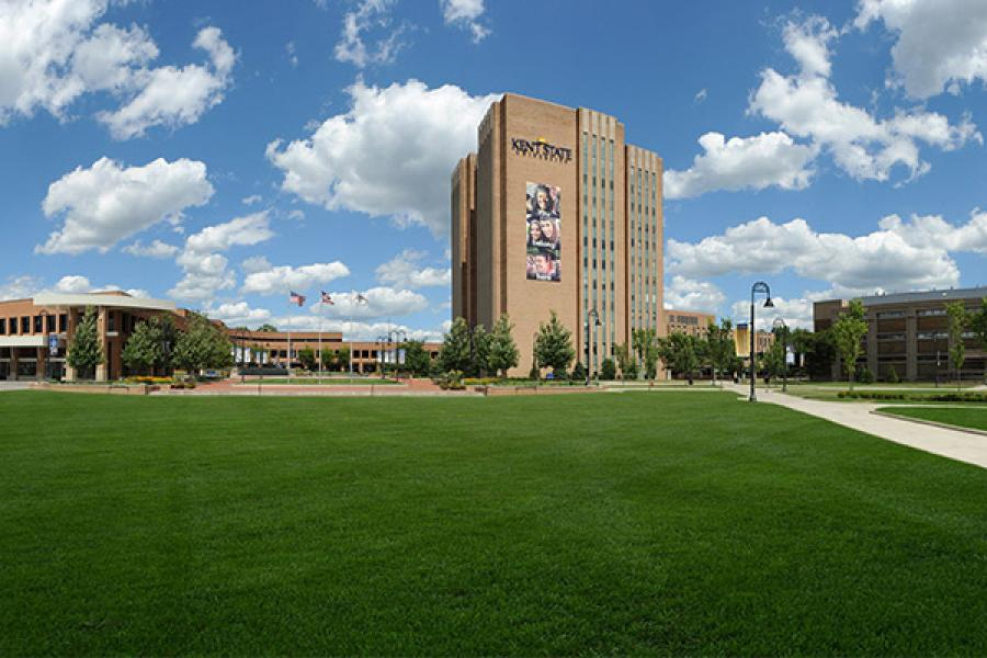 View of the University Library on the Kent Campus during a partly-cloudy day. The library is the tallest building in Portage County.