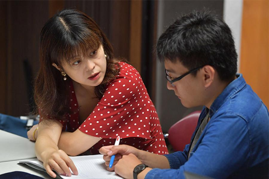 A student is receiving student support services to succeed by an instructor.