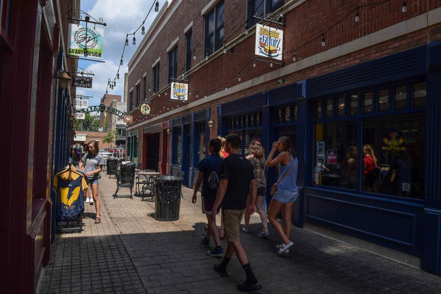 Students walk through downtown Kent during a recent visit to campus.