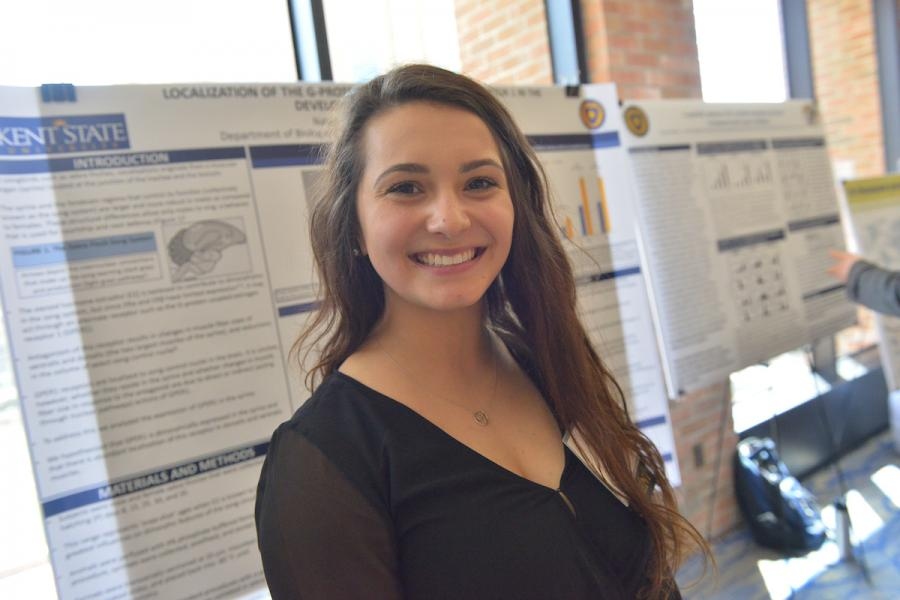 A female student participates in an event at the Kent Student Center.