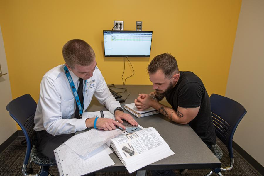 Student meets with professor for tutoring
