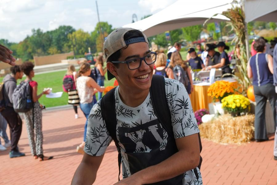 Student at an event in Risman Plaza