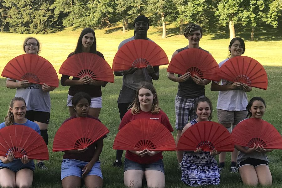 High school students from Portage County and surrounding areas hold Chinese hand fans during a past STARTALK Summer Foreign Language Camp at Kent State.