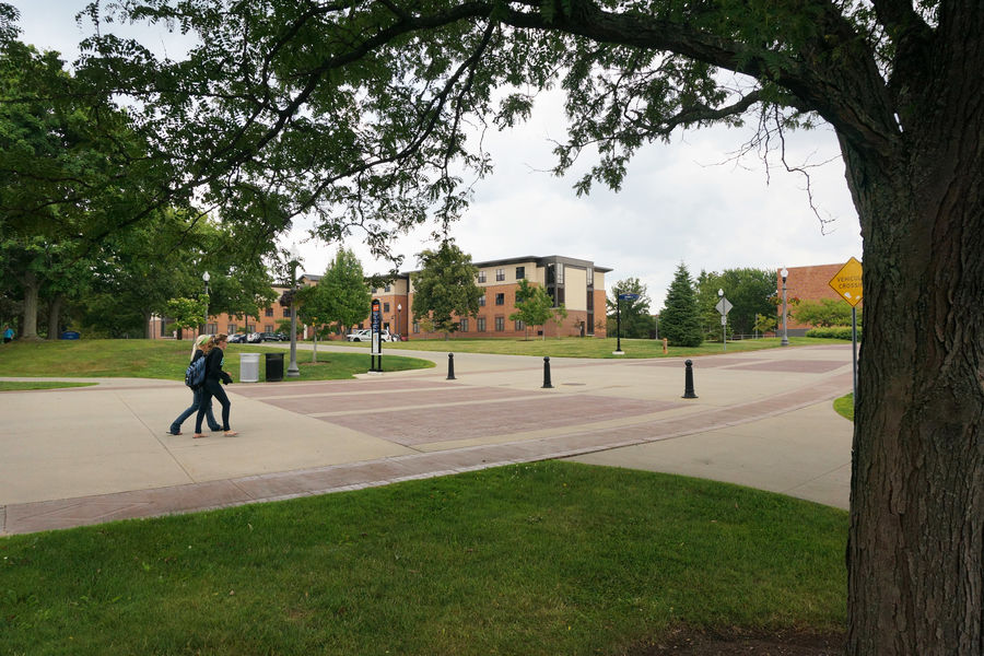 Students walk past the honors college