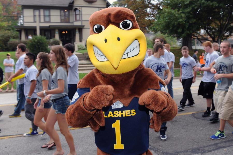 """""""Flash,"""" the Kent State mascot, hams it up during the 2013 Kent State homecoming Parade as it makes its way from campus to downtown Kent."""