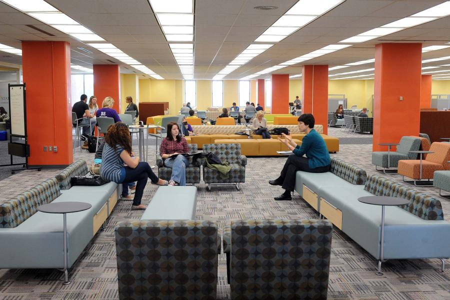 Students share conversation in the Fab Fourth, a student lounge on the fourth floor of the library where students can study, talk or just hang out between classes.