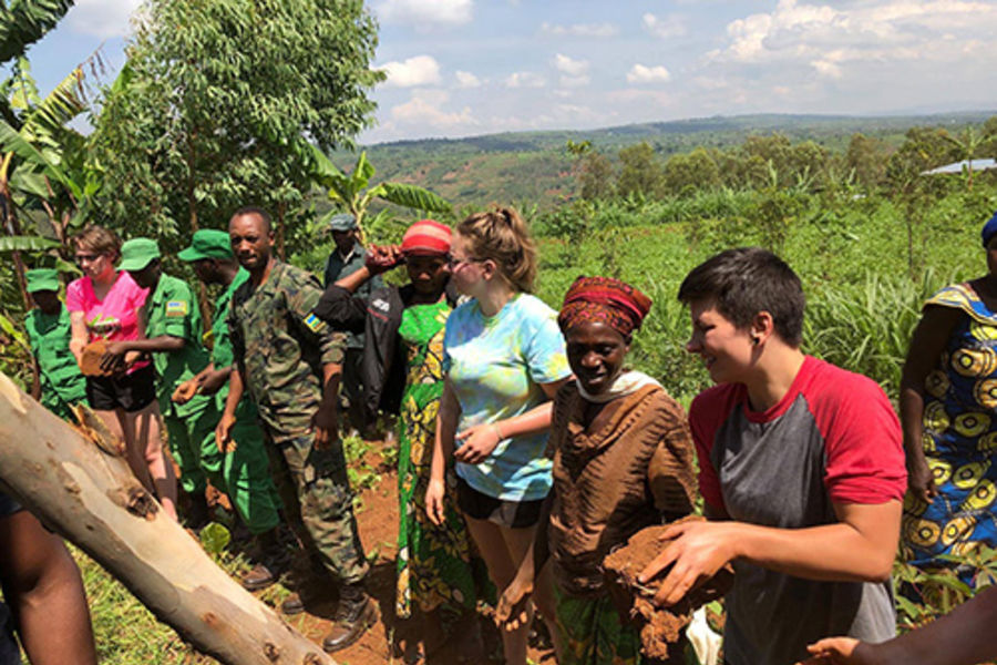 A group of students doing community service on a trip abroad