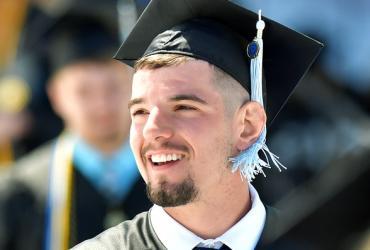 Photo of student in graduation cap