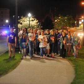 President Beverly Warren leads a candlelight vigil