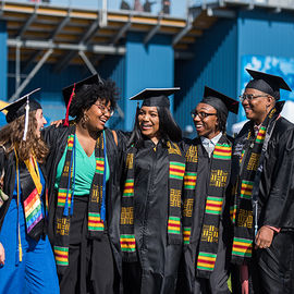 Students smiling at Spring 2019 Commencement