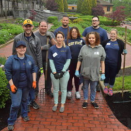 Kent State University alumni help clean up the gardens at the Akron Zoo.
