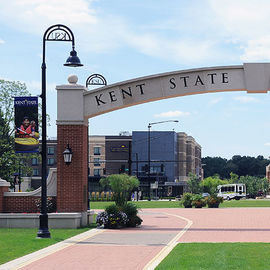 A view from the Lester A. Lefton Esplanade featuring the Kent State University arch and a view of Downtown Kent.