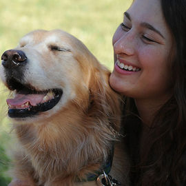 dog and owner smiling with eyes closed