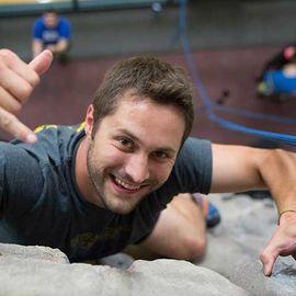 Rock climber enjoying the Student Recreation and Wellness Center's rock wall.